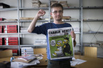 """French satirical weekly Charlie Hebdo's publisher, known only as Charb, clenches his fist as he presents to journalists, on September 19, 2012 in Paris, at the headquarters, the last issue which features on the front cover a satirical drawing titled """"Intouchables 2"""". Inside pages contain several cartoons caricaturing the Prophet Mohammed. The magazine's decision to publish the cartoons came against a background of unrest across the Islamic world over a crude US-made film that mocks Mohammed and portrays Muslims as gratuitously violent. The title refers to """"Intouchables"""", a 2012 French movie, the most seen French movie abroad, which is selected to represent France for the Oscars nominees, according to one of his directors, Eric Toledano. AFP PHOTO FRED DUFOUR        (Photo credit should read FRED DUFOUR/AFP/GettyImages)"""